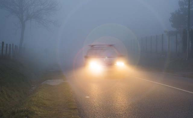 Car Head Light While Driving in Fog